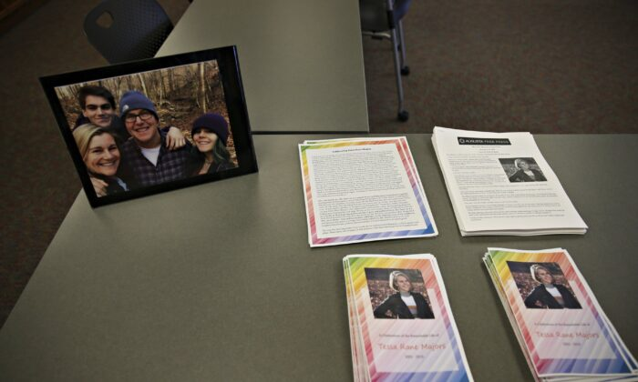 Photos, articles, and letters are laid out on display before a ceremony honoring Tessa Majors at St. Anne's Belfield School in Charlottesville, Va., on Dec. 21, 2019. (Erin Edgerton/The Daily Progress/AP)