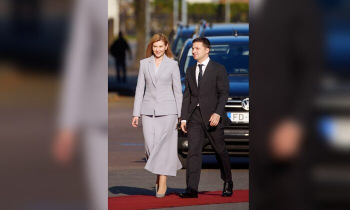 President of Ukraine Volodymyr Zelensky (R) and his wife, First Lady of Ukraine Olena Zelenska arrive to meet the President of Latvia at the Riga Castle square in Riga, Latvia, on Oct. 16, 2019. (Gints Ivuskans/AFP/Getty Images)