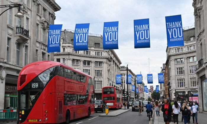 'Thank You' flags fly above shoppers and buses on Oxford Street in London on June 15, 2020. (Glyn Kirk/AFP via Getty Images)