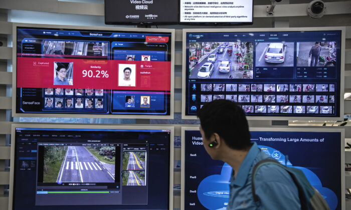 A display for facial recognition and artificial intelligence on monitors at Huawei's Bantian campus in Shenzhen, China, on April 26, 2019. (Kevin Frayer/Getty Images)