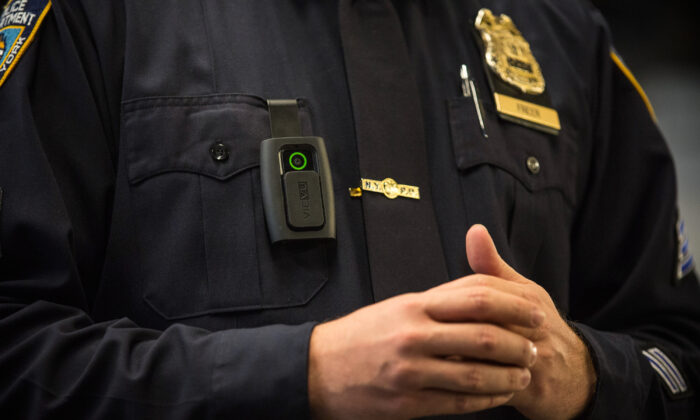 A New York City police officer wears a body camera during a press conference in New York in 2014. (Andrew Burton/Getty Images)