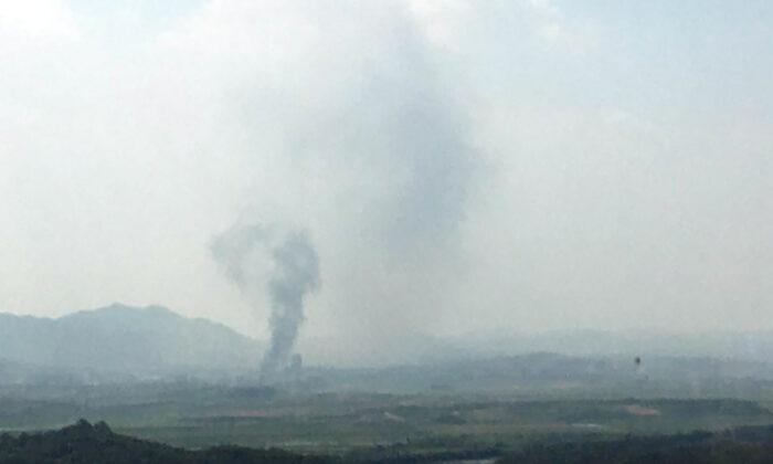 Smoke rises in the North Korean border town of Kaesong, seen from Paju, South Korea, on June 16, 2020. (Yonhap via AP)