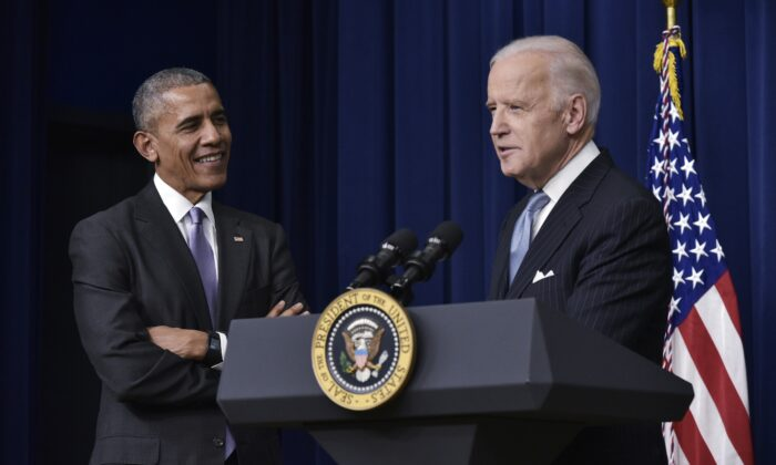 Then-Vice President Joe Biden, right, speaks, is watched by then-President Barack Obama during a signing ceremony next to the White House on Dec. 13, 2016. (Mandel Ngan/AFP via Getty Images)