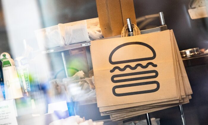 Shake Shack paper bags hang at a restaurant in New York City, N.Y., on April 20, 2020.  (Jeenah Moon/Getty Images)