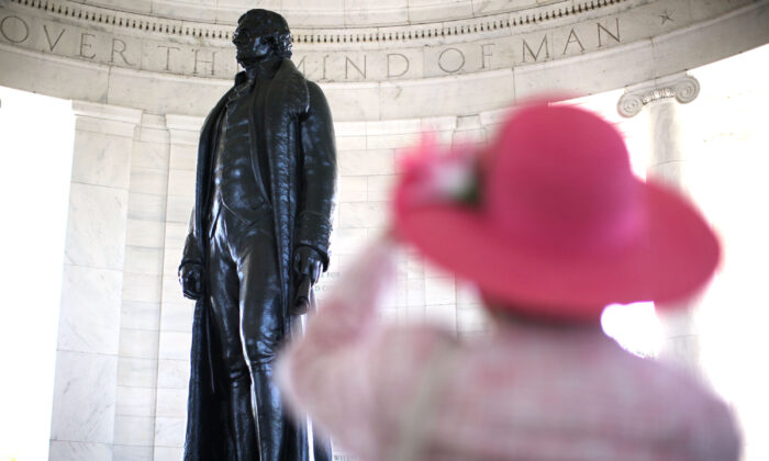 Bertrand L. Taylor III, a member of the Monticello Cabinet of The Thomas Jefferson Foundation, takes photographs of the statue of Thomas Jefferson after the 69th annual Jefferson Memorial Ceremony April 13, 2012 at Thomas Jefferson Memorial in Washington. (Alex Wong/Getty Images)