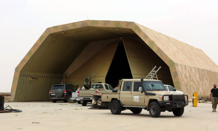 Vehicles are seen outside a hangar at Al-Watiya airbase also known as Okba Ibn Nafa airbase, which was seized by forces loyal to Libya's UN-recognised Government of National Accord (GNA), southwest of the capital Tripoli, on May 18, 2020. (Mahmud Turkia/AFP via Getty Images)
