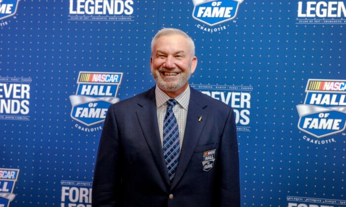 Former driver and television commentator Dale Jarrett poses for photographers on the red carpet before the start of the NASCAR Hall of Fame Induction ceremony in Charlotte, N.C., on Jan. 20. 2017. (Mike McCarn/File/AP Photo)