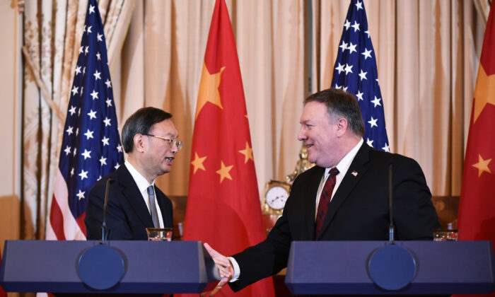 Secretary of State Mike Pompeo and Chinese politburo member Yang Jiechi shake hands following a press conference during the U.S.-China Diplomatic and Security Dialogue in the Benjamin Franklin Room of the State Department in Washington, on Nov. 9, 2018. (Mandel Ngan/ AFP/Getty Images)