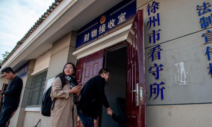 Xu Yan, wife of human rights lawyer Yu Wensheng, enters an office at the Xuzhou City Detention Center in Xuzhou, Jiangsu Province, China, on Oct. 30, 2019. (Nicolas Asfouri/AFP via Getty Images)