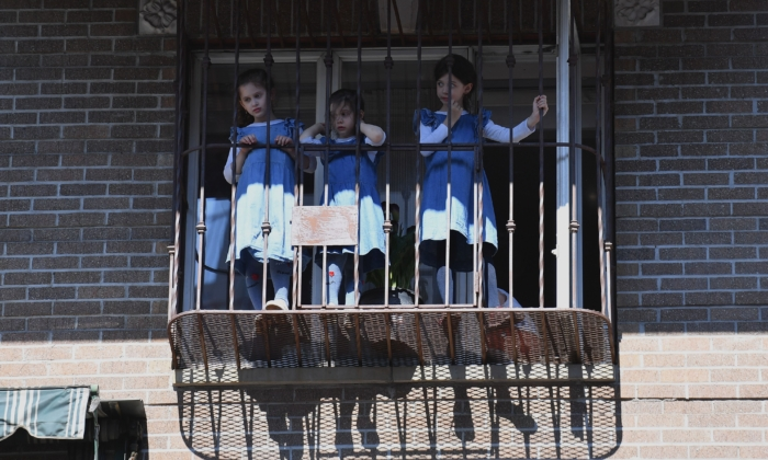 "Orthodox Jewish girls watch from their windows as protesters walk through the Brooklyn borough on June 3, 2020, during a ""Breonna Taylor and Black Lives Matter"" protest in New York City. (Angela Weiss/AFP via Getty Images)"