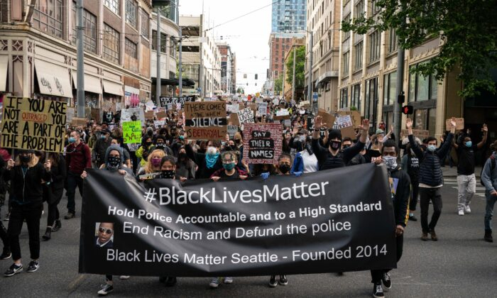 Black Lives Matter protesters march through a downtown street in Seattle on June 14, 2020. (David Ryder/Getty Images)