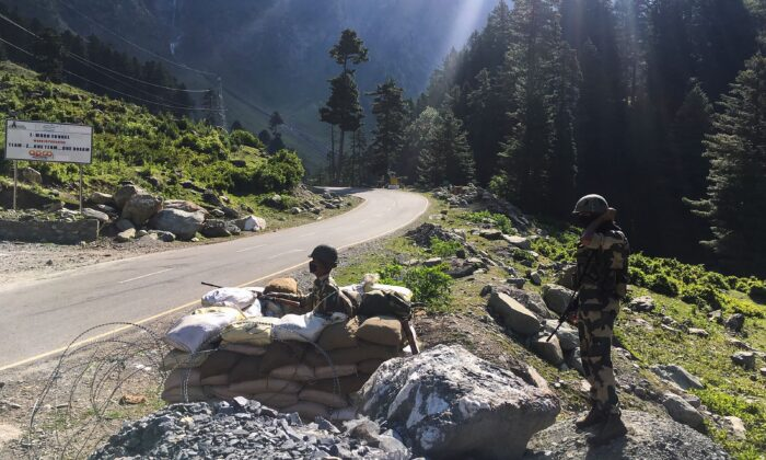 Indian Border Security Force (BSF) soldiers guard a highway leading towards Leh, bordering China, in Gagangir, India, on June 17, 2020. (Tauseef Mustafa/AFP via Getty Images)