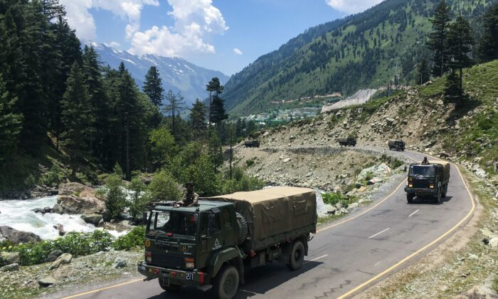 Indian army convoys make their way towards Leh, bordering China, in Gagangir, India on June 17, 2020. (TAUSEEF MUSTAFA/AFP via Getty Images)