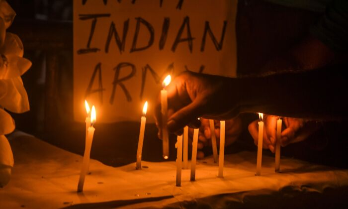 Congress Party workers and supporters light candles to pay tribute to the soldiers who lost their lives following a recent clash between India and China, in Kolkata, India, on June 17, 2020. (DIBYANGSHU SARKAR/AFP via Getty Images)
