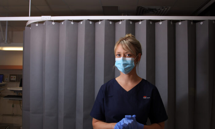 Registered Nurse Clancy Spencer poses in the clinical assessment room at St George Hospital COVID-19/ Flu Assessment Clinic on May 15, 2020 in Sydney, Australia.  (Lisa Maree Williams/Getty Images)