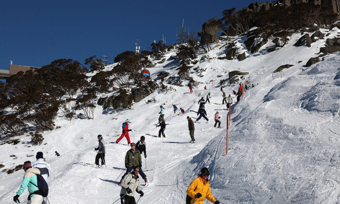 Skiers and snowboarders head down the eagle way run on July 9, 2009 in Thredbo, Australia. (Stuart Hannagan/Getty Images)
