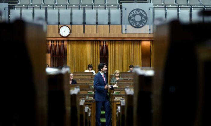 Prime Minister Justin Trudeau rises during a meeting of the Special Committee on the COVID-19 Pandemic in the House of Commons on Parliament Hill in Ottawa, on June 16, 2020. (Justin Tang/The Canadian Press)