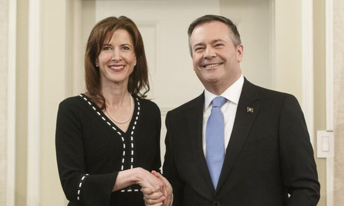 Alberta premier Jason Kenney shakes hands with Tanya Fir Minister of Economic Development, Trade and Tourism is sworn into office, in Edmonton on April 30, 2019. (Jason Franson/The Canadian Press)