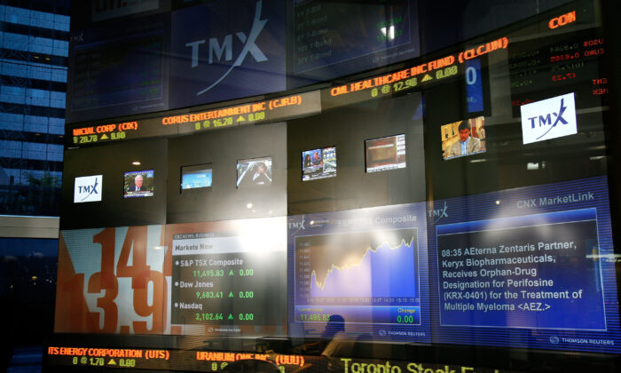 A multimedia information screen for the Toronto Stock Exchange in Toronto in a file photo. Provincial securities regulators are working on rules to ensure investors have reliable financial information on Canadian companies with overseas operations and foreign companies that trade on Canada's stock exchanges. (Malcolm Taylor/Getty Images)