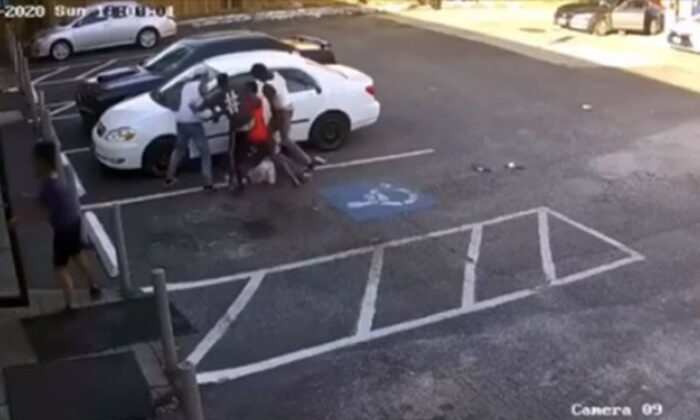 Multiple suspects are seen on video kicking and punching a man near a gas station in Klein, Texas, in June. (Mark Herman, constable of Harris County Precinct 4)