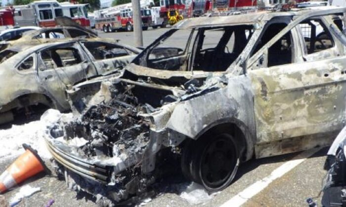 A police car that was torched during riots in Philadelphia, Penn., on May 30, 2020. (FBI)