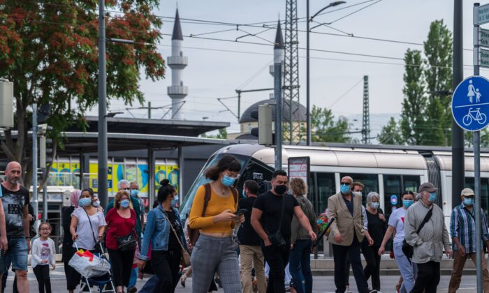 French passengers step out of the tram at a station in Kehl, on June 15, 2020, on the reopening day of the borders between France and Germany, (Patrick Hertzog/AFP via Getty Images)