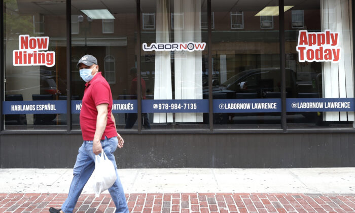 A man walks by a career center storefront in Lawrence, Mass., on June 5, 2020. (Elise Amendola/AP Photo)