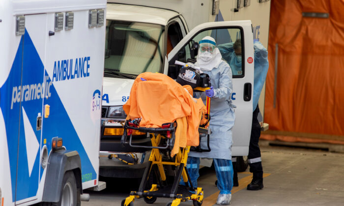 A paramedic transports a patient to Mount Sinai Hospital as the number of the coronavirus disease (COVID-19) cases continues to grow in Toronto, Ontario, Canada, on April 17, 2020.  (Carlos Osorio/Reuters)