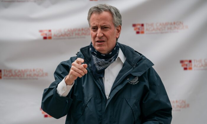 New York City Mayor Bill de Blasio speaks at a food shelf organized by The Campaign Against Hunger in Bed Stuy, Brooklyn in New York City, N.Y., on April 14, 2020. (Scott Heins/Getty Images)