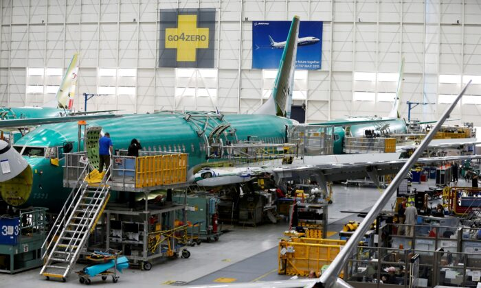 Technicians work near the door of a 737 Max aircraft at the Boeing factory in Renton, Wash., on March 27, 2019. (Lindsey Wasson/Reuters)