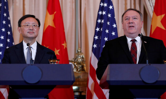 U.S. Secretary of State Mike Pompeo (R), speaks as CCP Office of Foreign Affairs Director Yang Jiechi listens as the two countries hold a joint news conference after participating in a second diplomatic and security meeting at the U.S. Department of State, Washington on Nov. 9, 2018. (Leah Millis/Reuters)