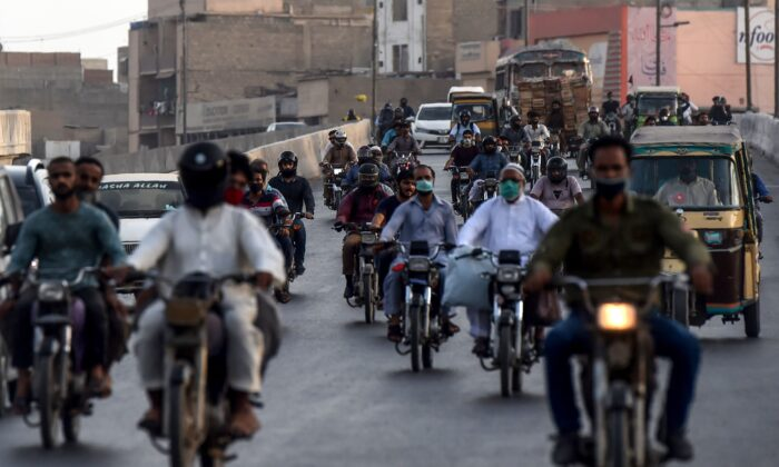 Motorists make their way on a busy street in Karachi, Pakistan, as COVID-19 coronavirus cases still increase in the country on June 17, 2020. (ASIF HASSAN/AFP via Getty Images)