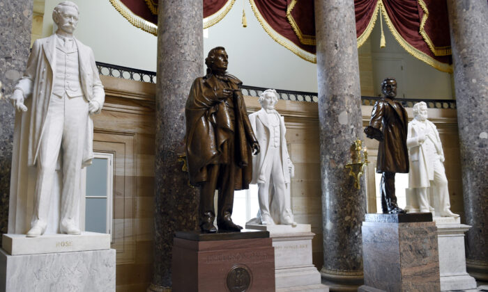In this June 24, 2015 file photo, a statue of Jefferson Davis, second from left, president of the Confederate States from 1861 to 1865, is on display in Statuary Hall on Capitol Hill in Washington. House Speaker Nancy Pelosi is demanding that statues of Confederate figures such as Jefferson Davis be removed from the U.S. Capitol. (Susan Walsh/AP Photo)