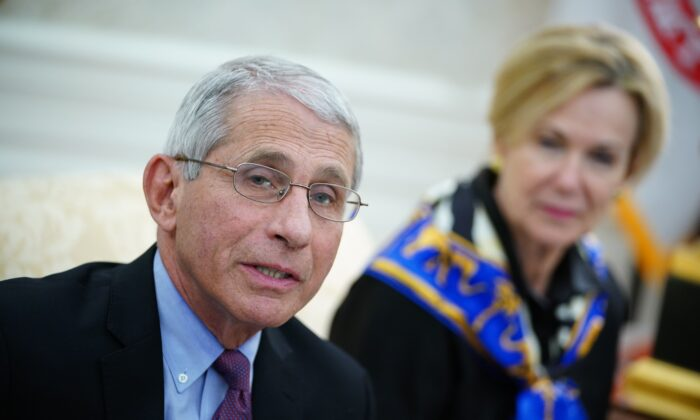 Dr. Anthony Fauci (L) director of the National Institute of Allergy and Infectious Diseases speaks in the Oval Office of the White House in Washington on April 29, 2020. (Mandel Ngan/AFP via Getty Images)