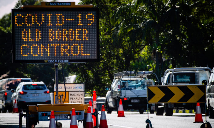 Vehicle checkpoint on the Pacific Highway on the Queensland-New South Wales border in  Brisbane on April 15, 2020. (Patrick Hamilton /AFP via Getty Images)