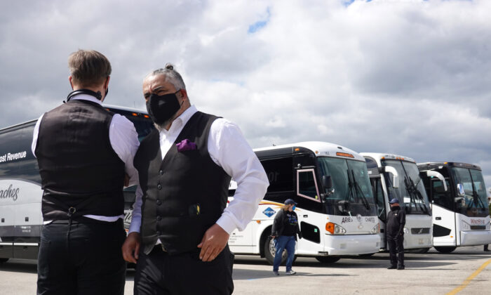 Motorcoach owners and drivers stand near O'Hare Airport in Rosemont, Ill., on May 11, 2020. (Scott Olson/Getty Images)