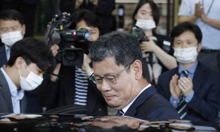 South Korean Unification Minister Kim Yeon-chul gets into a car as he leaves the government complex in Seoul, South Korea, on June 19, 2020. (Lee Jin-man/AP Photo)