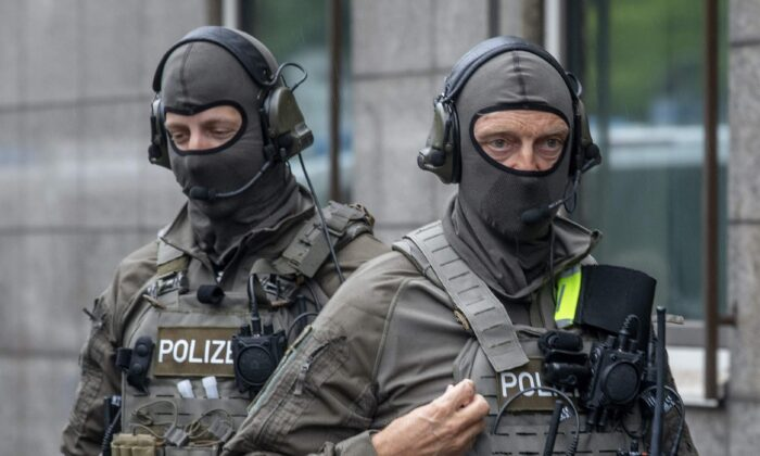 Special Police forces stand in front of the justice building, in Frankfurt, Germany, on June 16, 2020. (AP Photo/Michael Probst)