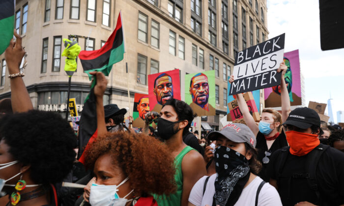 Thousands of people participate in a march in Manhattan, N.Y., on June 19, 2020. (Spencer Platt/Getty Images)