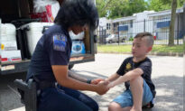 7-Year-Old Boy Prays With Local Police Officers Amid Protests, His 'Mission' Goes Viral