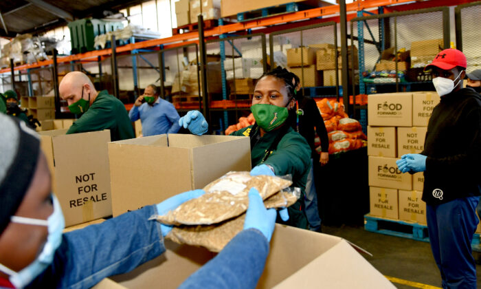 Springbok Women's rugby players pack food parcels in the fight against hunger at the Food Forward SA warehouse in Cape Town, South Africa, on June 18, 2020. (Ashley Vlotman/Gallo Images/Getty Images)