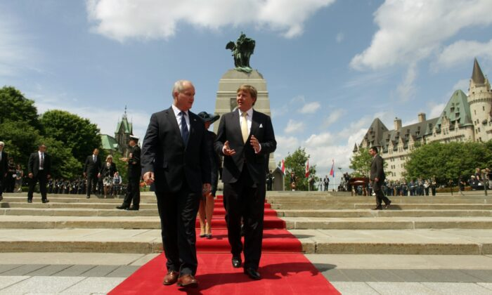 Canada's Minister of Veterans Affairs Erin O'Toole (L) walks with King Willem-Alexander of the Netherlands during a wreath laying ceremony at The Tomb of the Unknown Soldieron May 27, 2015 in Ottawa, Canada. The King and Queen is on a three-day visit to Canada. (Photo by Dave Chan/AFP via Getty Images)