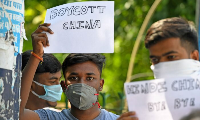 Protesters display placards urging citizens to boycott Chinese goods during a demonstration in New Delhi, India, on June 18, 2020. (Prakash Singh/AFP via Getty Images)