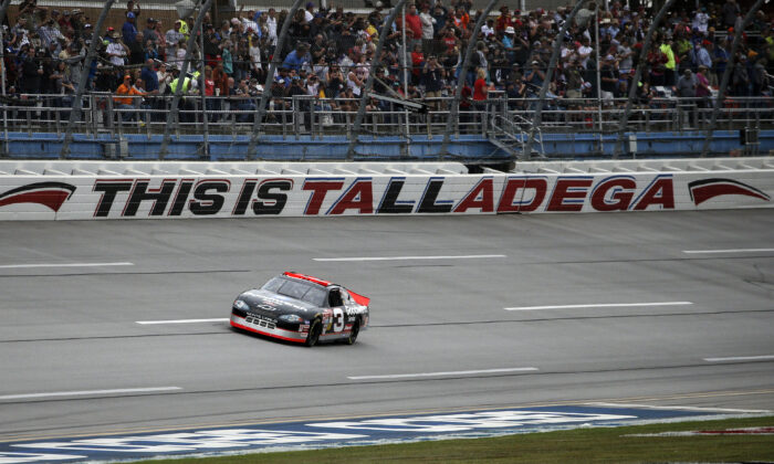 No. 3 car of the late NASCAR driver Dale Earnhardt Sr., driven by Richard Childress, takes a lap before a NASCAR Cup Series auto race at Talladega Superspeedway in Talladega, Ala, Oct. 13, 2019. (Butch Dill/AP photo)