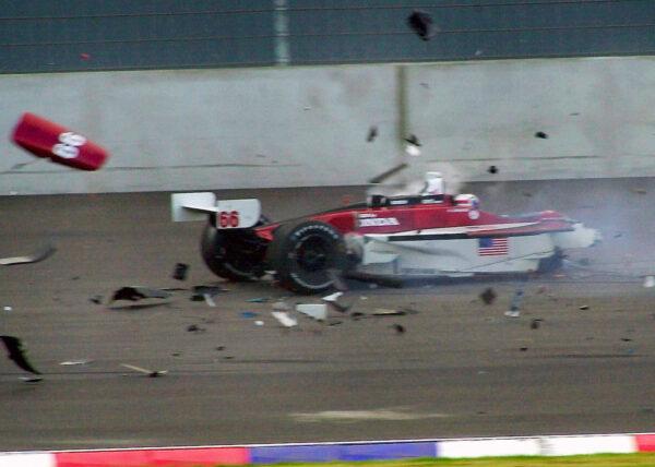 Italian driver Alex Zanardi sitting in his car