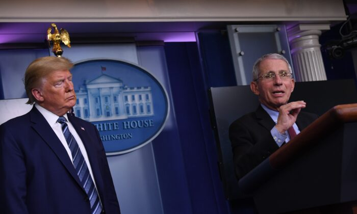 Dr. Anthony Fauci (R) speaks while President Donald Trump listens, during a White House Coronavirus Task Force briefing at the White House in Washington on April 5, 2020. (Eric Baradat/AFP via Getty Images)