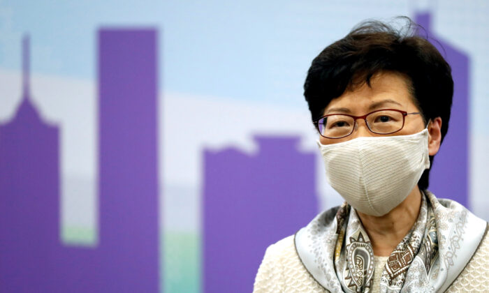 Hong Kong Chief Executive Carrie Lam, wearing a face mask following the CCP virus outbreak, holds a news conference in Beijing, China, on June 3, 2020. (Carlos Garcia Rawlins/Reuters)