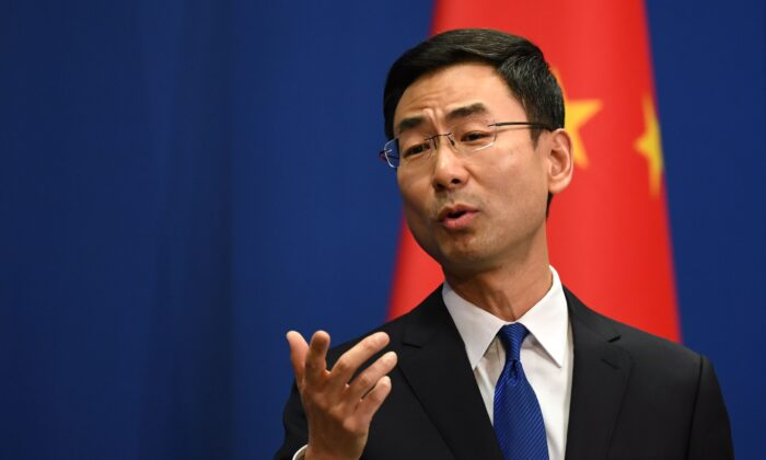 Chinese Foreign Ministry spokesman Geng Shuang speaks during the daily press briefing in Beijing on March 18, 2020. (Greg Baker/AFP via Getty Images)