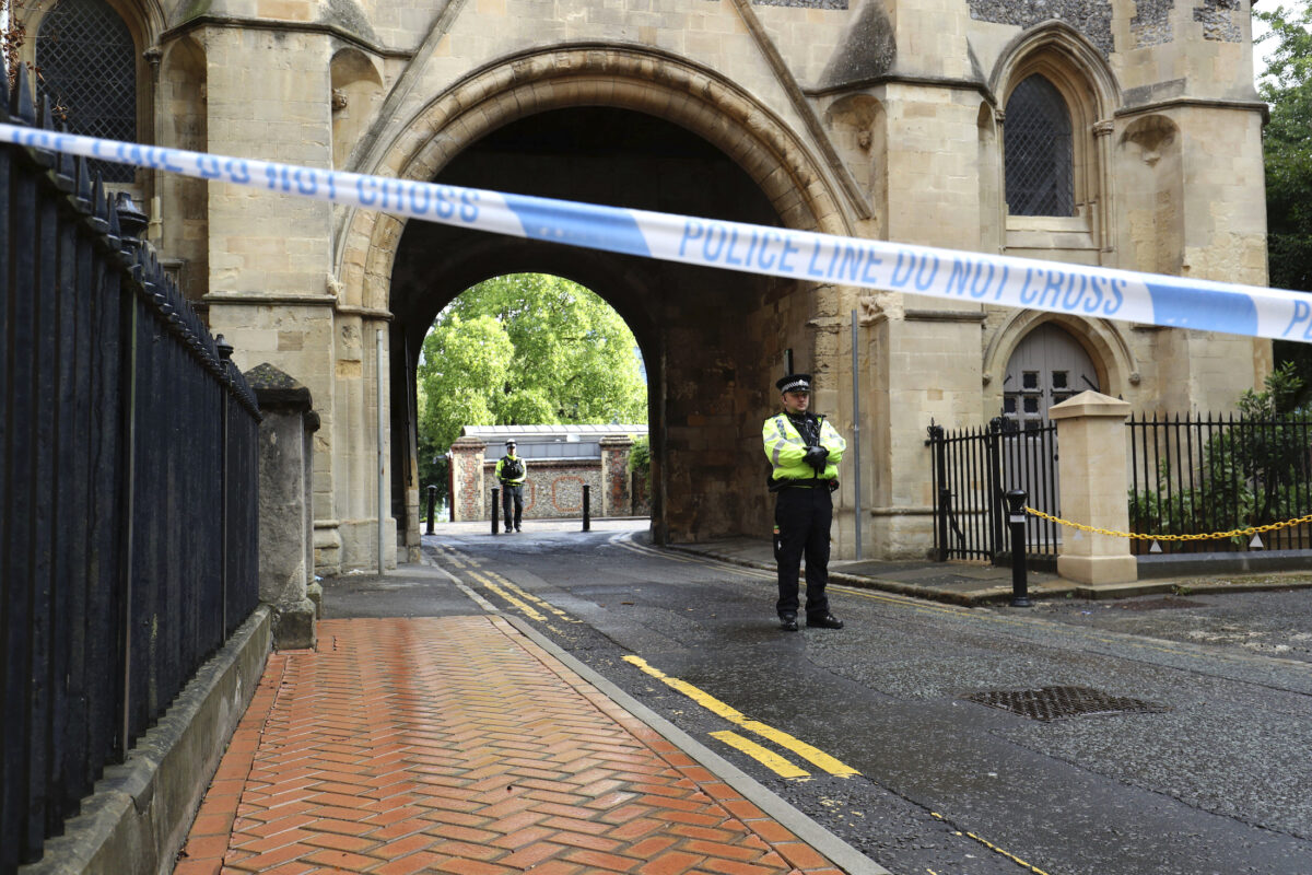 Police stand guard at the Abbey gateway