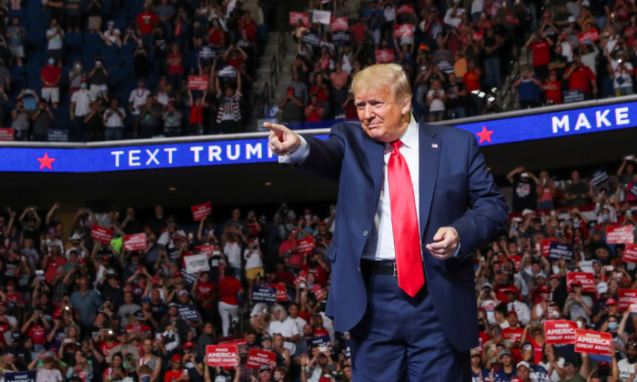 President Donald Trump points at the crowd as he enters his first re-election campaign rally in several months in the midst of the CCP virus outbreak, at the BOK Center in Tulsa, Okla., on June 20, 2020. (Leah Millis/Reuters)